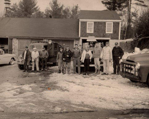 Volunteer Firefighters of the Holland Fire Department in front of the old fire station