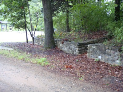 Stone wall and steps leading up to a former residence